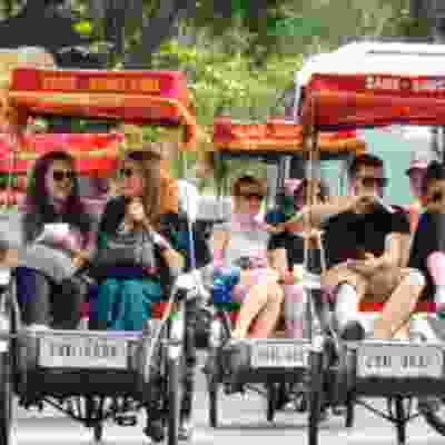 Tour Hanoi in traditional rickshaws with your group